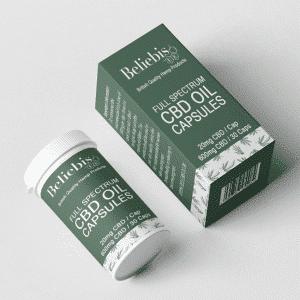 CBD Capsules tube & box laying down.