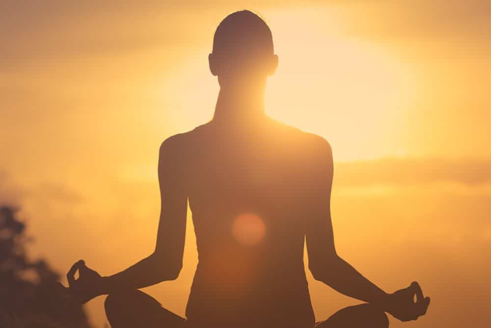 Woman relaxed and meditating with CBD