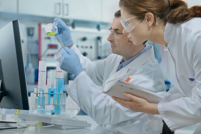 UK Laboratory workers testing premium CBD products
