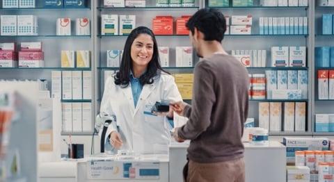 Man buying premium CBD oil in a pharmacy
