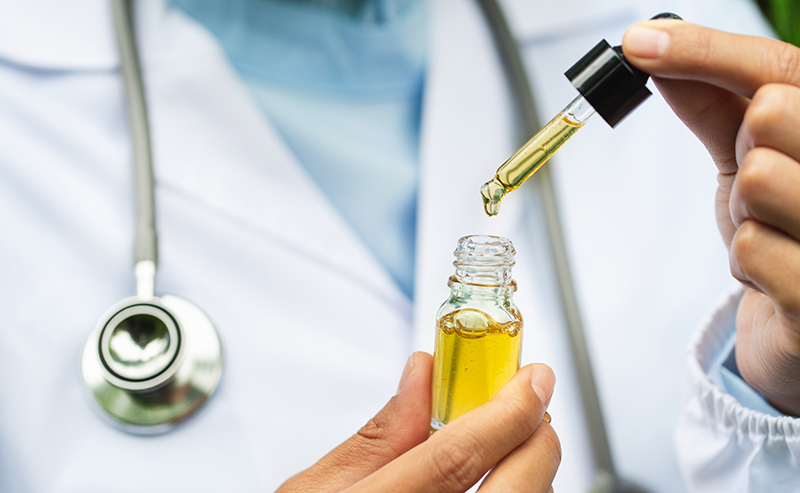 Doctor checking CBD oil for quality and purity