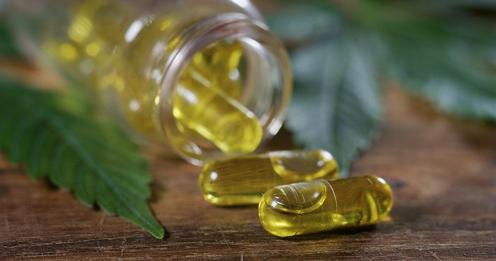 Close up of a jar of full spectrum cbd oil capsules